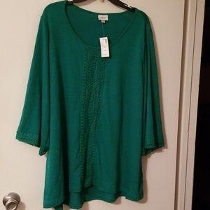 Deep green blouse, tags still on it
